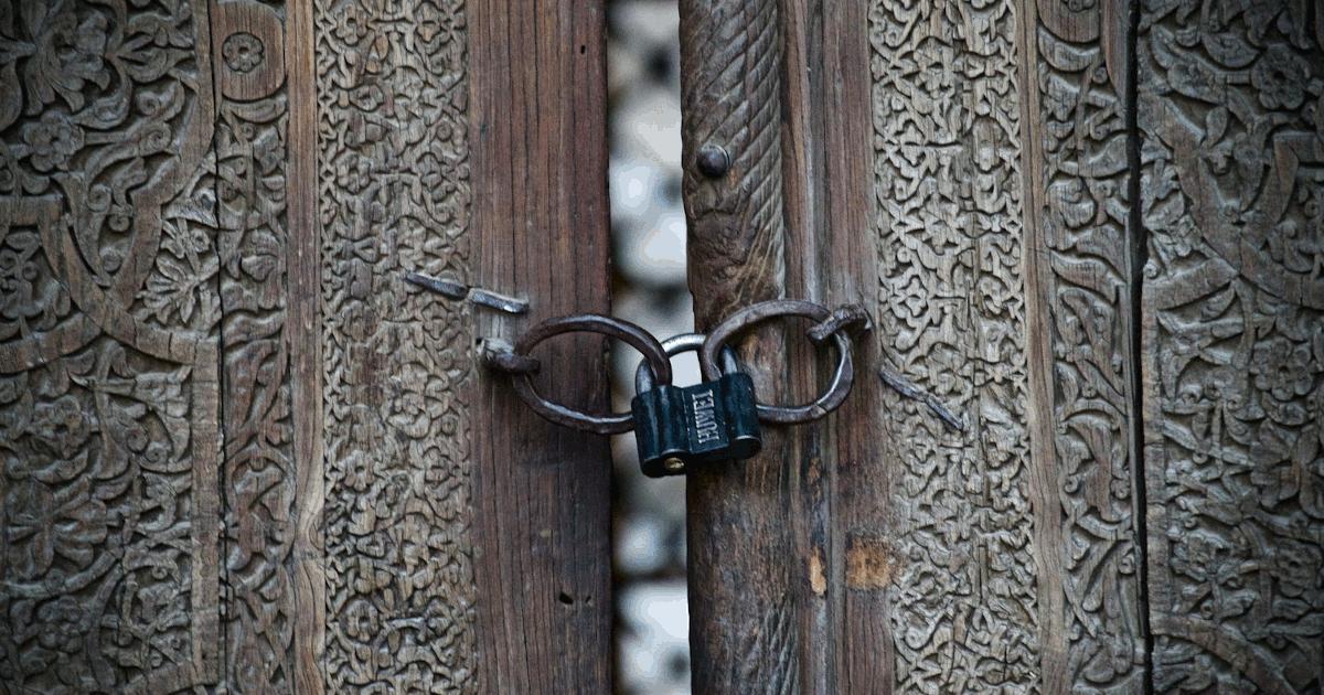 Padlock on a wooden door